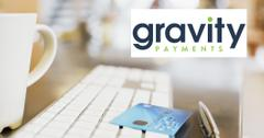 Gravity Payments logo over credit card