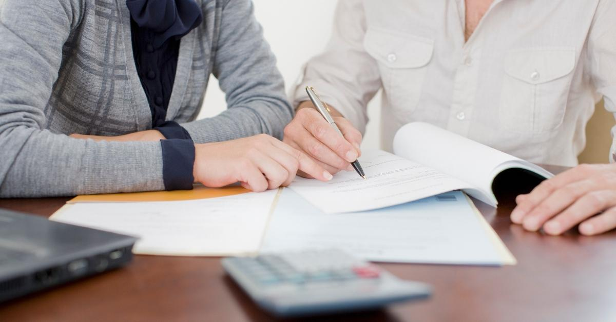People reviewing documents for a share-secured loan