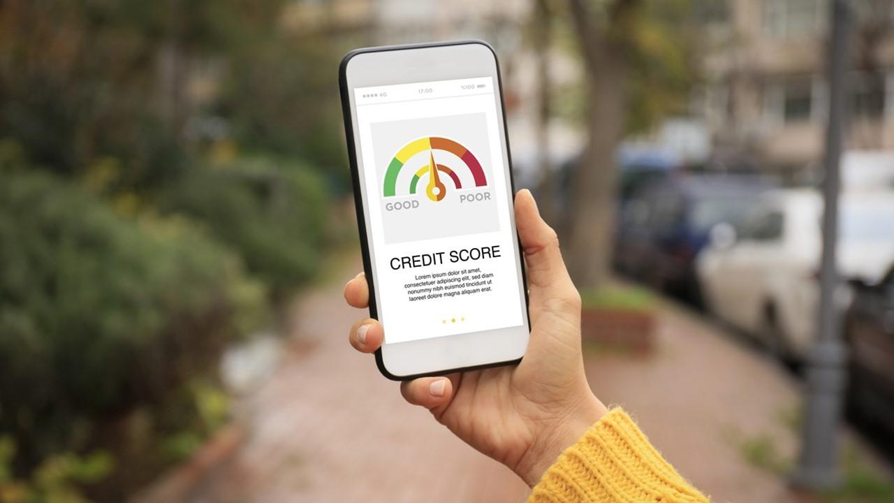 Woman checking her credit score on a smartphone
