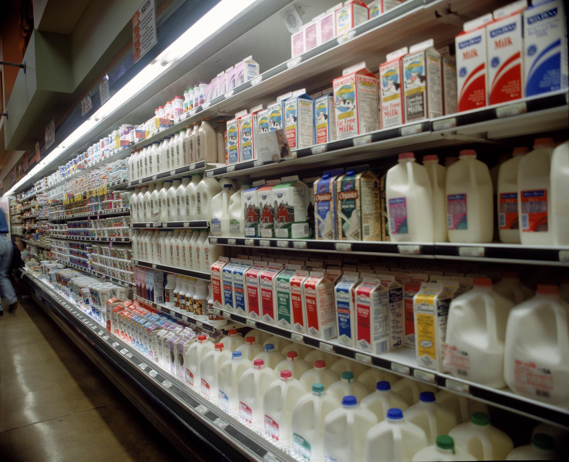 Shelves of milk and consumer staples at a grocery store