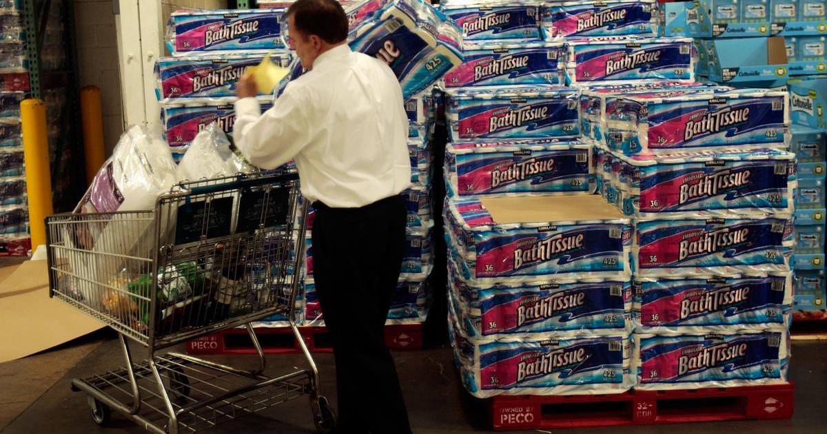Man buying toilet paper