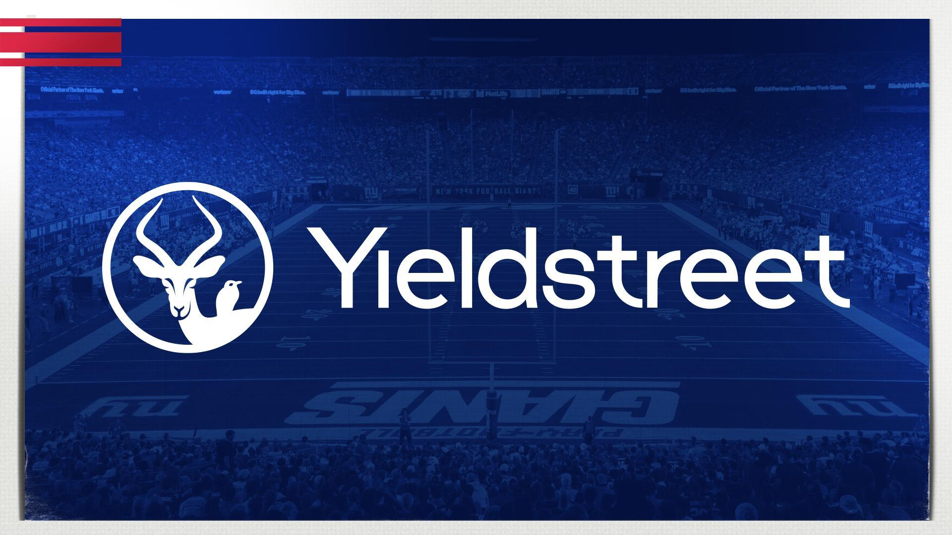 Yieldstreet logo over the Giants field