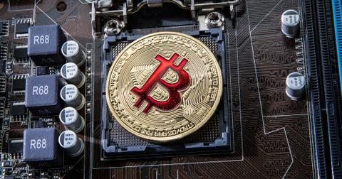 uploads/2019/12/gold-bit-coin-btc-coins-on-the-motherboard-bitcoin-is-a-worldwi.jpg