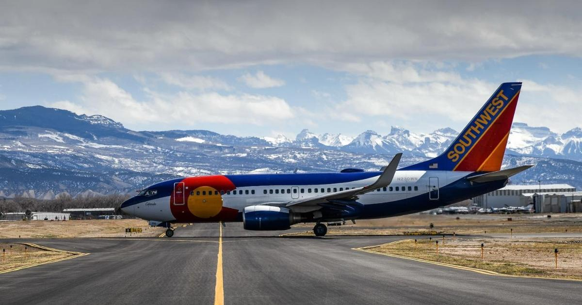 Southwest Airlines jet with mountains in the background