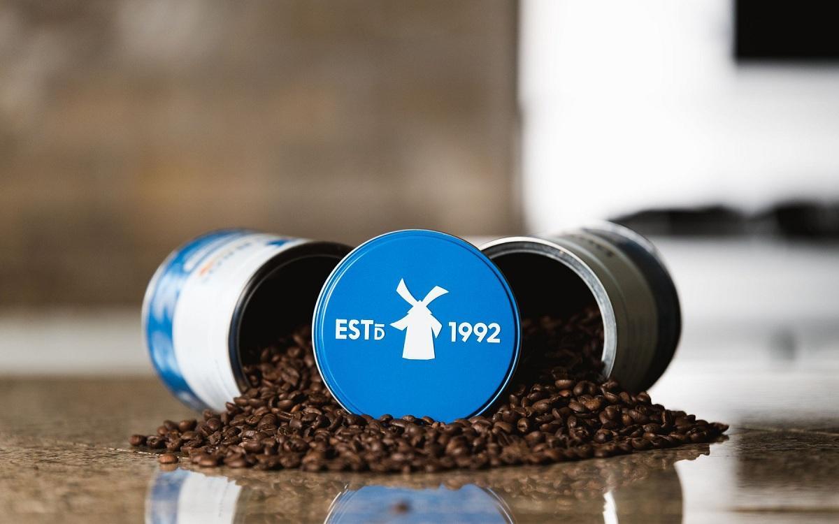 Dutch Bros coffee tins and beans