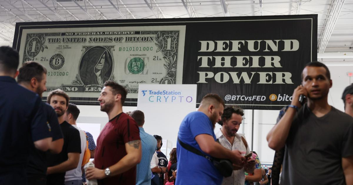 People standing in front of a DeFi banner