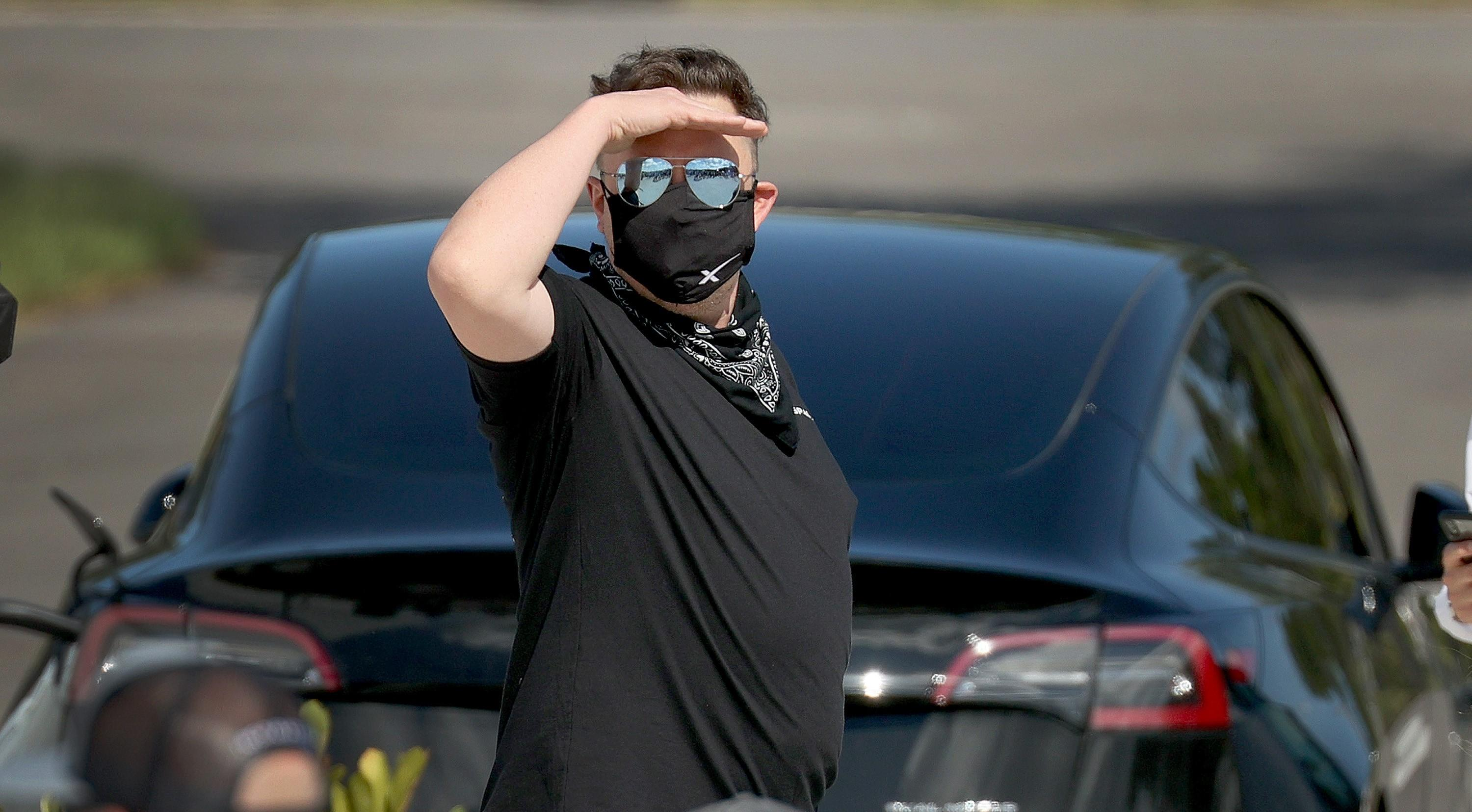 Elon Musk wearing glasses and mask