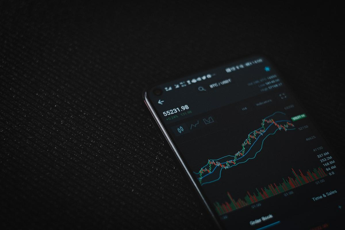 A mobile phone displaying a cryptocurrency price chart