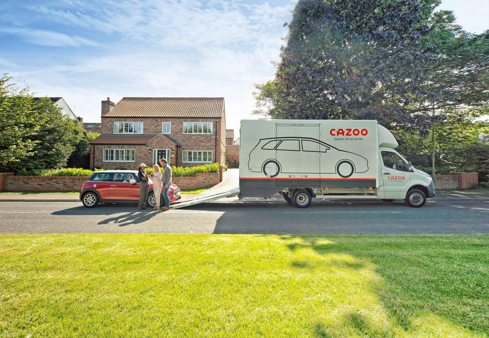 A used car being delivered by Cazoo
